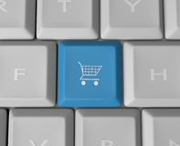 Shopping Cart Keyboard Button. A blue shopping cart key button on a computer keyboard Stock Photo