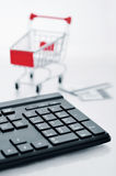 Shopping cart and keyboard Stock Images