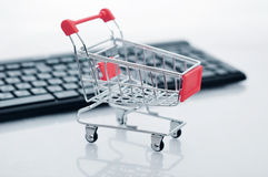 Shopping cart and keyboard Stock Photos