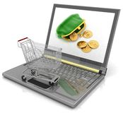 Shopping-cart and laptop Stock Images