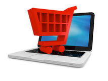 Shopping cart on laptop Stock Photos