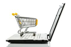 Shopping cart and laptop royalty free stock photos