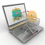 Shopping cart and laptop Royalty Free Stock Photo