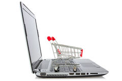 Shopping cart and laptop Stock Photography