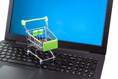 Shopping cart on laptop. Keyboard. Online shopping concept Stock Photos