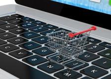 Shopping cart on laptop Royalty Free Stock Photos