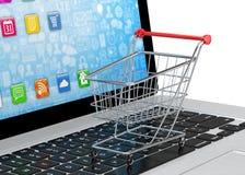 Shopping cart on laptop Stock Image