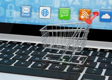 Shopping cart on laptop Stock Photography