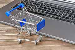 Shopping cart and laptop Stock Photo
