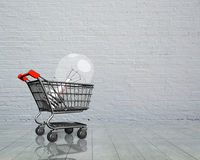 Shopping cart with large light bulb Royalty Free Stock Images