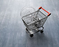 Shopping cart with large light bulb. Small shopping cart with large light bulb, high angle view, on wooden floor background royalty free stock photography