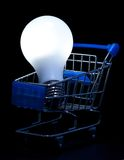 Shopping cart with lightning light bulb Royalty Free Stock Photos