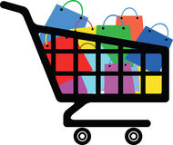 Shopping cart with a lot of colorful bags Royalty Free Stock Images