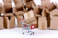 Shopping cart with many open boxes Stock Photography