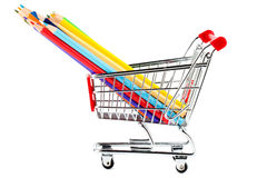 Shopping cart with many pencils Royalty Free Stock Photography