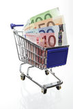 Shopping cart with money Royalty Free Stock Image