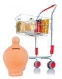 Shopping cart with money box and food products Stock Images