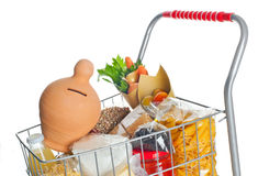 Shopping cart with money box and food products Stock Photo