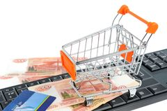 Shopping cart, money, credit card on keyboard Royalty Free Stock Images