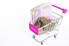 Shopping cart and money Thai bath Stock Photos