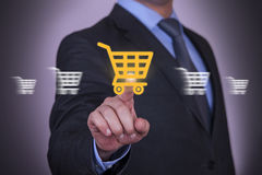 Shopping Cart Motion on Touch Screen. On working business concept Stock Images