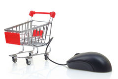 Shopping cart with a mouse Stock Photos