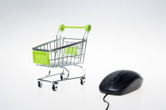 Shopping cart and mouse Stock Photography