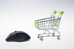 Shopping cart and mouse Stock Images