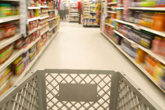 Shopping cart moving through market Stock Photography