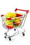 Shopping cart with muffins. Isolated on white background royalty free stock photography