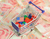 Shopping cart with national flag on a lot of Renminbi Royalty Free Stock Images