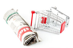Shopping Cart and Newspaper Stock Image