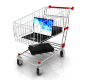 Shopping cart and notebooks Stock Photo