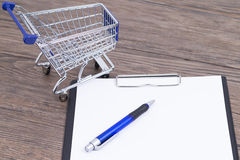 Shopping cart with notepad Stock Images