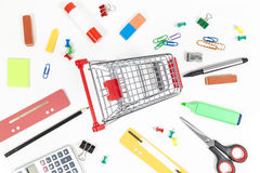 Shopping cart and office supplies Stock Image