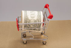 Shopping Cart with one dollar Royalty Free Stock Images