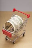 Shopping Cart with one dollar Stock Photos