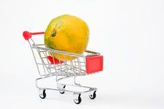 Shopping cart with orange. Orange in shopping basket isolated Stock Photo