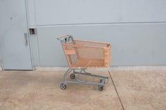 Shopping cart with orange basket Stock Image