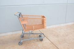Shopping cart with orange basket Stock Photo