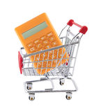 Shopping cart with orange calculator Royalty Free Stock Photography