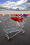 Shopping cart outside. Shopping cart in front of the supermarket Stock Photos