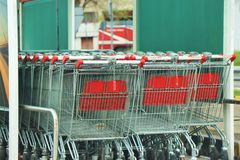 Shopping cart outside an Auchan supermarket. royalty free stock photo