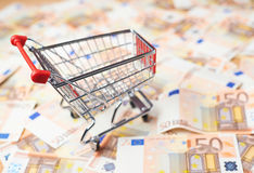 Shopping cart over the bank note bills Stock Images