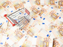 Shopping cart over the bank note bills Stock Photo