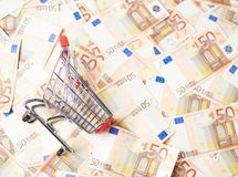 Shopping cart over the bank note bills Royalty Free Stock Photo