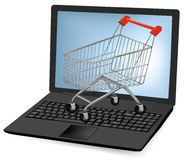Shopping cart over a laptop Stock Image