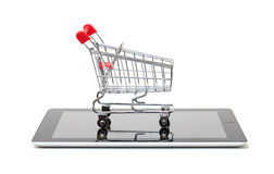 Shopping Cart over a Tablet PC Stock Image