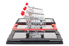 Shopping Cart over a Tablet PC Stock Photos