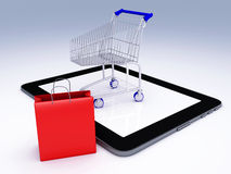 Shopping Cart over Tablet PC. E-commerce Concept. Royalty Free Stock Images